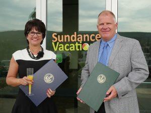 Sundance Vacations Co-Founders Accept Senate Citation for Company Milestone